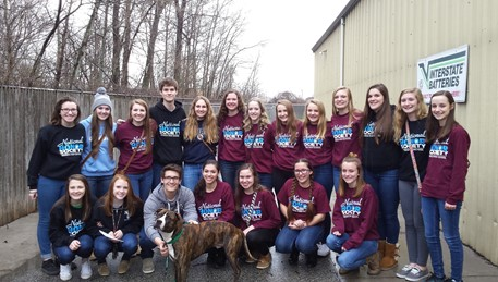 Zeek the dog with NHS members at the Anna Shelter